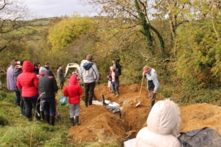 green-foundation-ireland-digging-trench-crowd