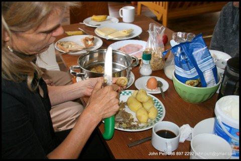 green-foundation-ireland-woman-peeling-potatoes