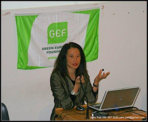 green-foundation-ireland-woman-presenting-green-foundation-flag