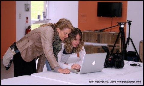 green-foundation-ireland-women-looking-at-computer